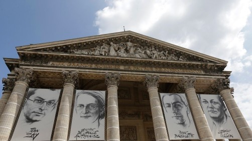 The portraits of four figures of the French Resistance, from L-R, Jean Zay, Genevieve de Gaulle Anthonioz, Pierre Brossolette, and Germaine Tillion are displayed at the Pantheon on the eve of a ceremony in Paris, France, May 26, 2015. France pays tribute to four members of the French Resistance in the second World War before the May 27 ceremony of their entrance to the Pantheon.   REUTERS/Philippe Wojazer - RTX1ELPR